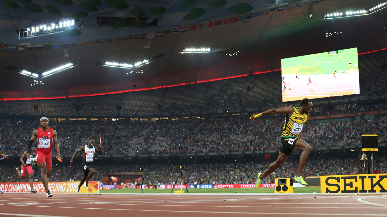 Usain Bolt crosses the finish line first for Jamaica in men's 4x100m relay with Mike Rodgers (USA) and Justyn Warner (Canada) chasing at the world championships in athletics on August 29, 2015.