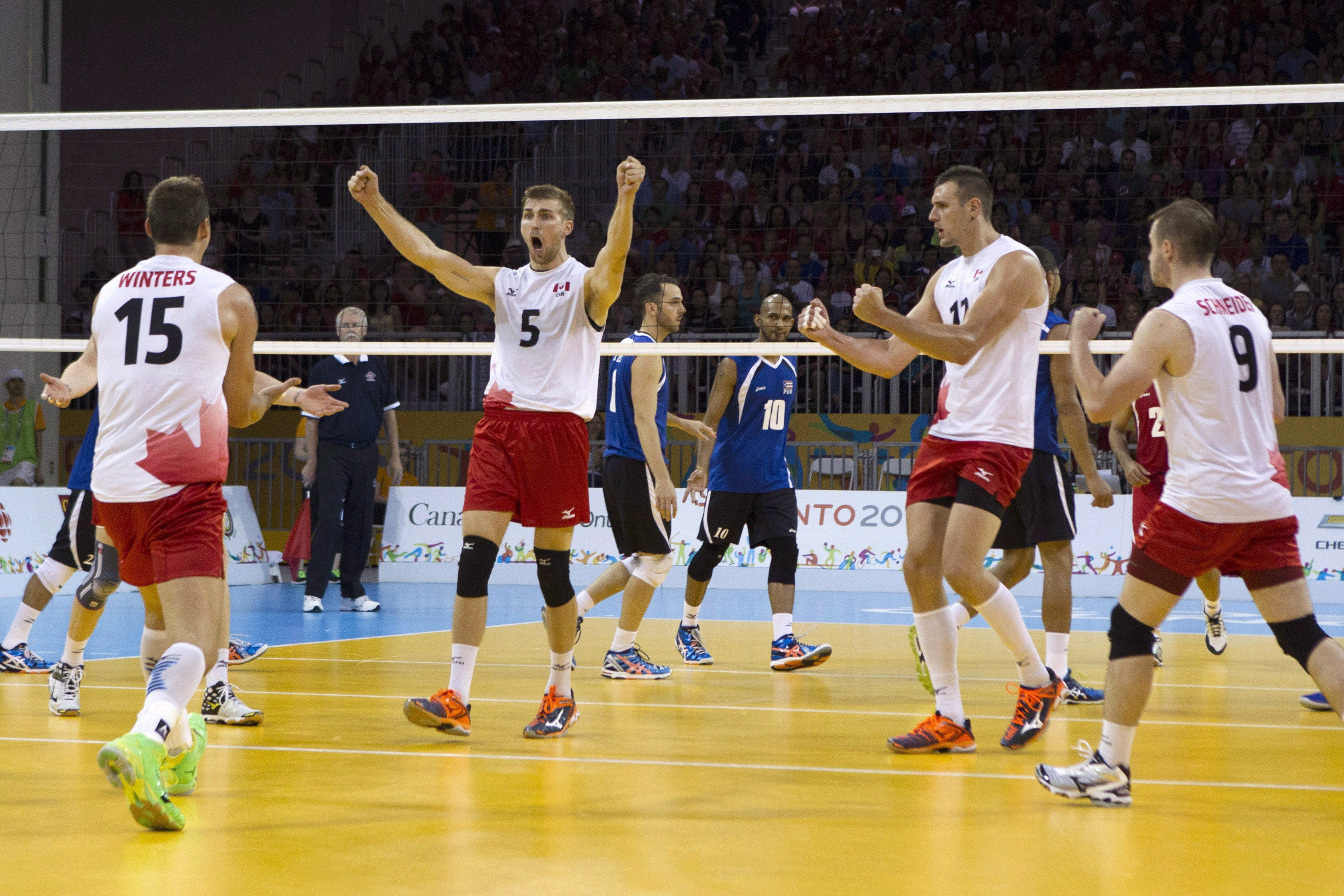 Members of the Canadian men's volleyball team celebrate a point during their 3-1 win over Puerto Rico in the men's volleyball bronze medal game at the Pan Am Toronto 2015 games in Toronto on Sunday, July 26, 2015. THE CANADIAN PRESS/Chris Young