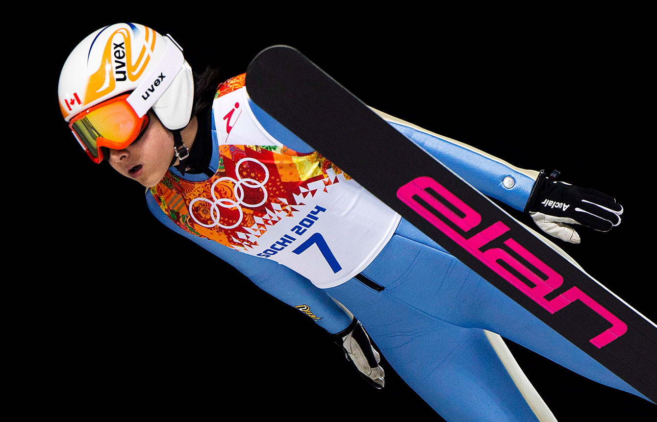 Canada's Atsuko Tanaka competes in the women's individual normal ski jumping event during the Sochi 2014 Olympic Winter Games in Krasnaya Polyana, Russia on Tuesday, February 11, 2014. THE CANADIAN PRESS/Nathan Denette