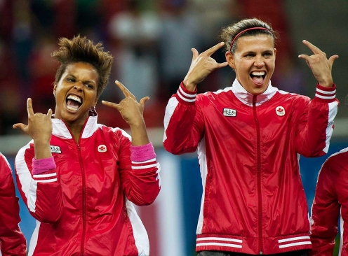 Karina LeBlanc (left) and Christine Sinclair celebrate their 2011 Pan Am gold medal.