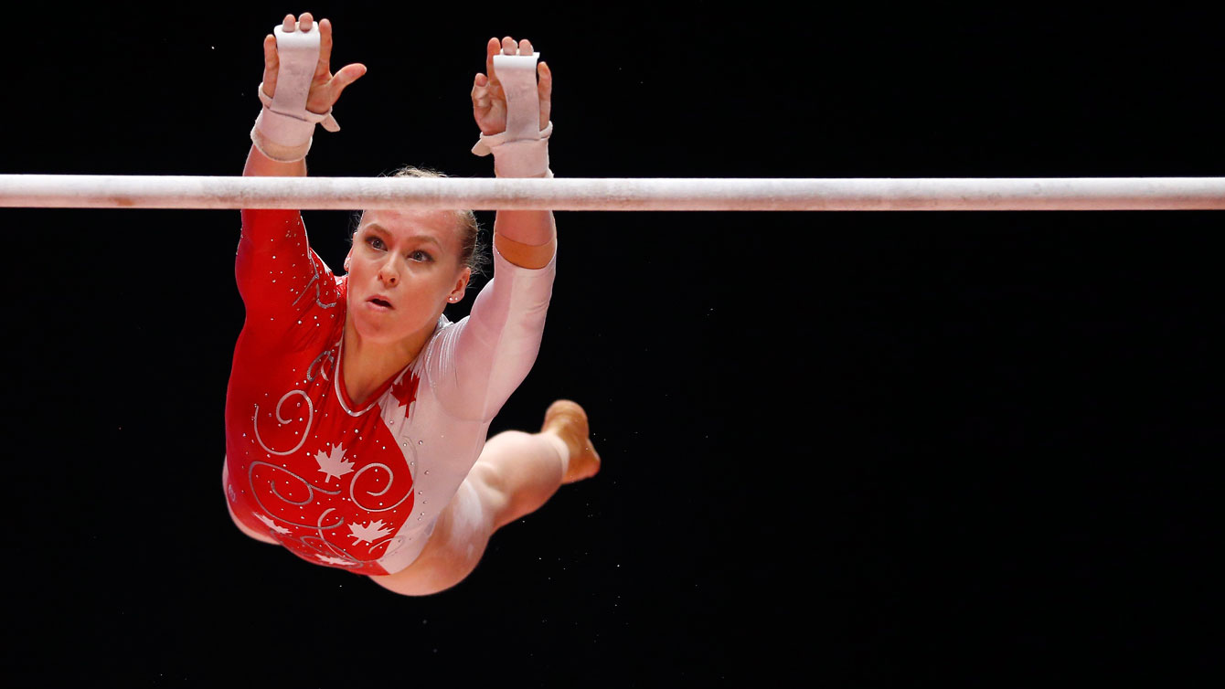 Ellie Black competes in the uneven bars at the world artistic gymnastics championship all-around finals in Glasgow on October 29, 2015.