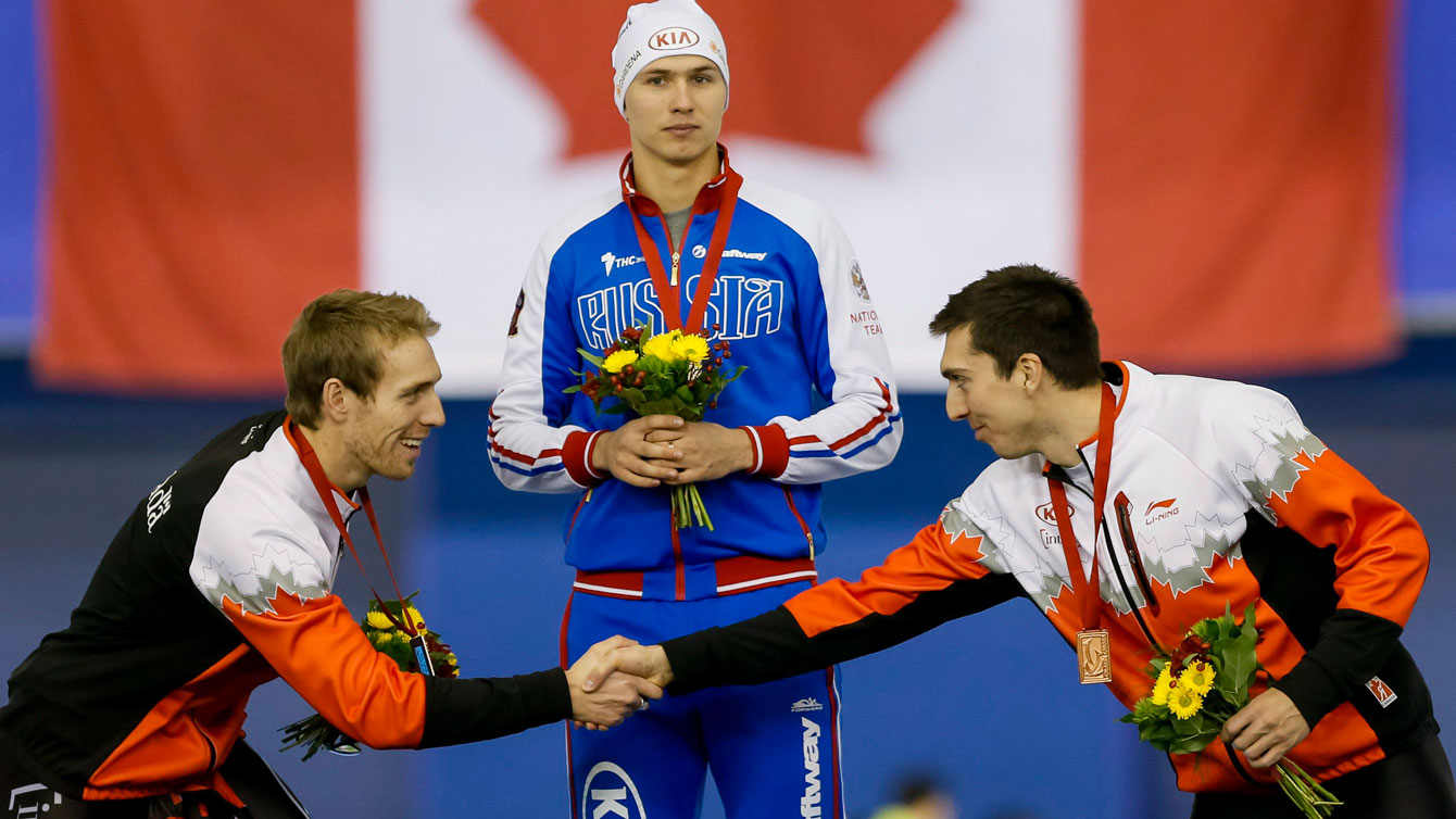 William Dutton (left) shakes hands with teammate and third-place finisher Alex Boisvert-Lacroix after the second World Cup 500m of the weekend in Calgary on November 15, 2015.
