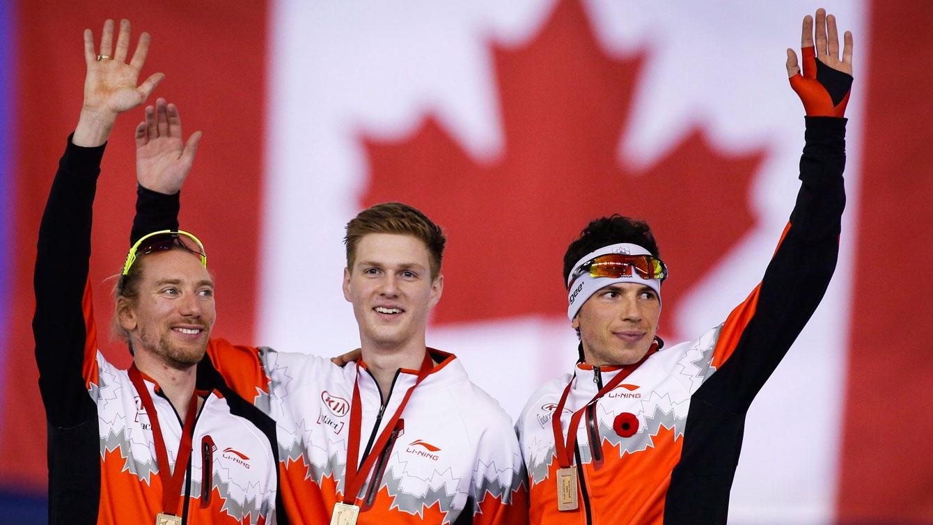 (L-R) Ted-Jan Bloemen, Benjamin Donnelly and Jordan Belchos celebrate team pursuit World Cup gold in Calgary on November 14, 2015.