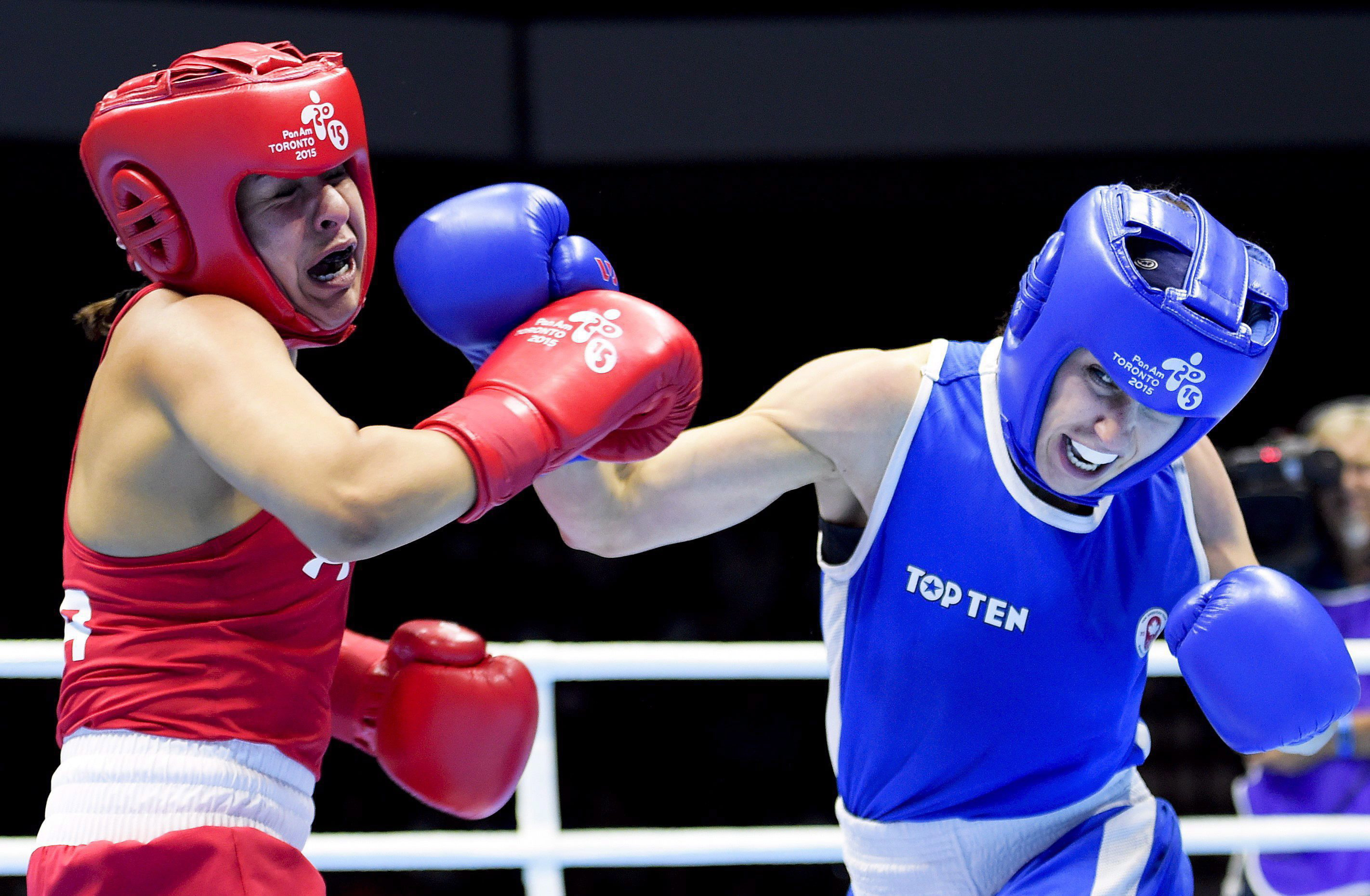 Mandy Bujold, right, of Canada, competes against Marlen Esparza, of the United States, in the women's 48-51kg flyweight gold medal boxing final during the Pan American Games in Oshawa, Ontario, on Thursday, July 25, 2015. Bujold won gold. THE CANADIAN PRESS/Nathan Denette