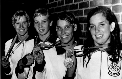 Four women hold their medals