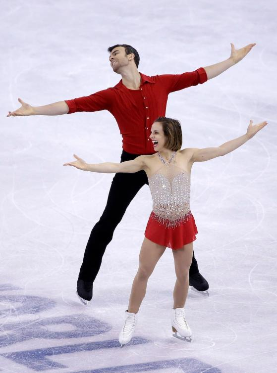 Meagan Duhamel and Eric Radford, of Canada, compete during the pairs short program in the World Figure Skating Championships, Friday, April 1, 2016, in Boston. (AP Photo/Elise Amendola)