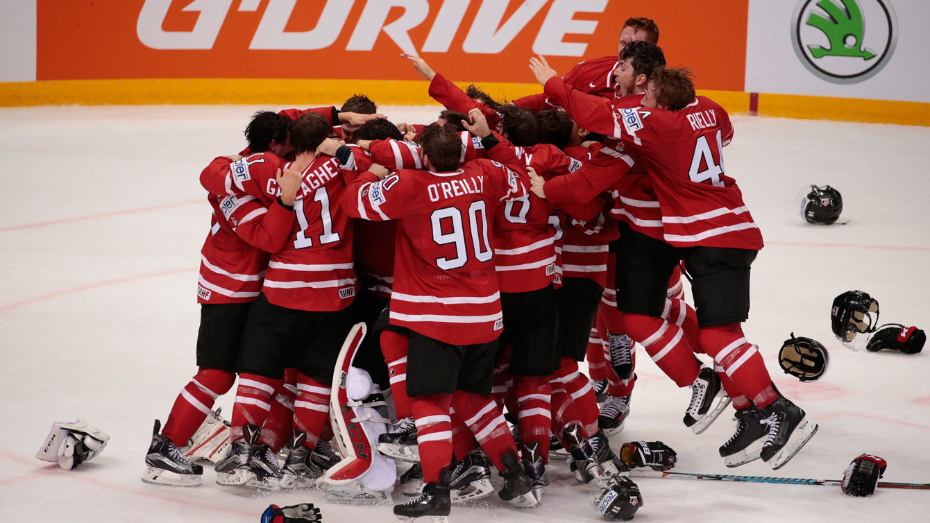 Canadian players celebrate winning gold at IIHF worlds final over Finland on May 22, 2016.