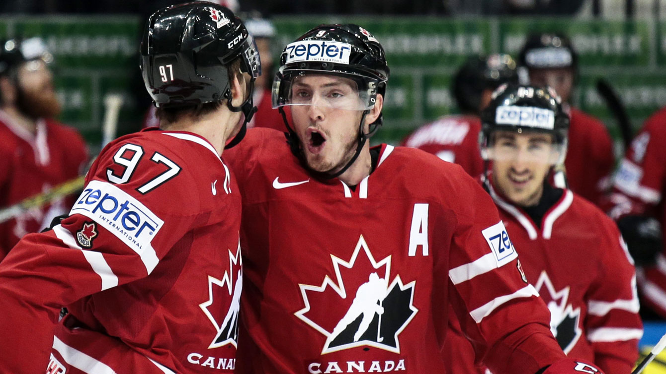 Connor McDavid (left) and Matt Duchene celebrate McDavid's first period goal at the IIHF worlds final on May 22, 2016.