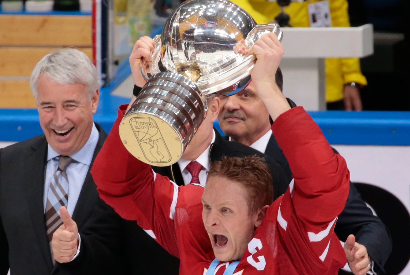 Corey Perry holds up the IIHF World Championship trophy after Canada beat Finland 2-0 on May 22, 2016.