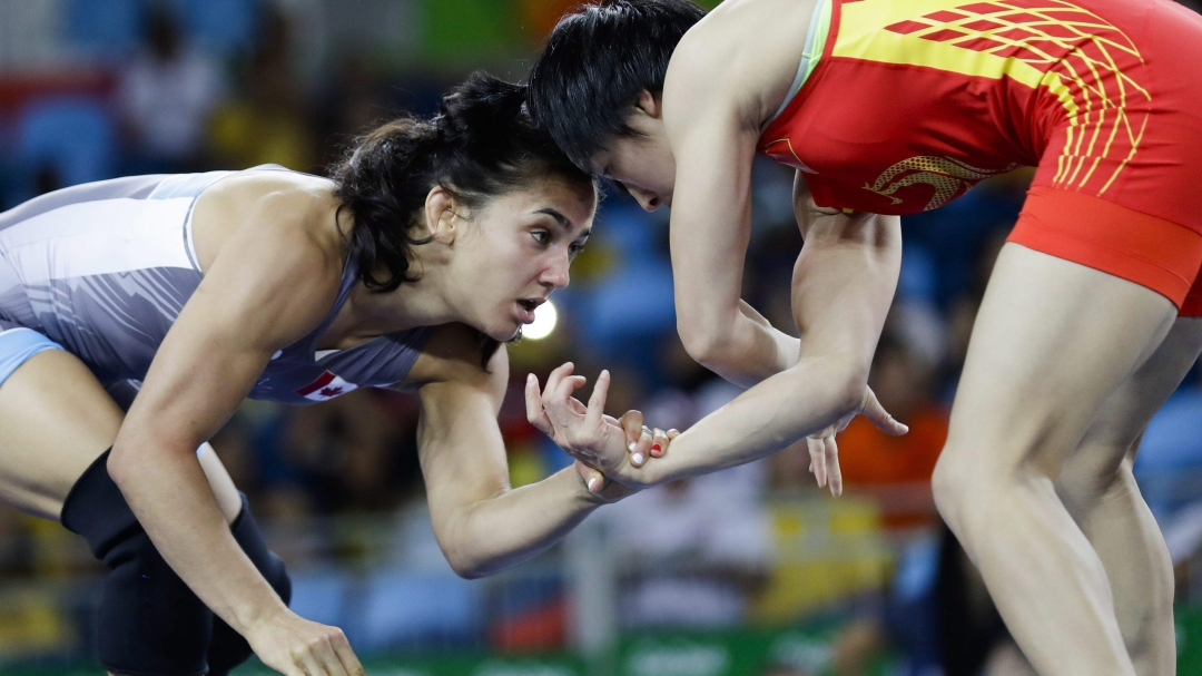 Canada's Jasmine Mian, blue, competes against China's Sun Yanan