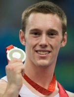 Canada's Jason Burnett, from Etobicoke, Ont. holds up his silver medal following competition in the mens trampoline final at the the Beijing Olympics in Beijing, China Tuesday, Aug.19, 2008. THE CANADIAN PRESS/Adrian Wyld