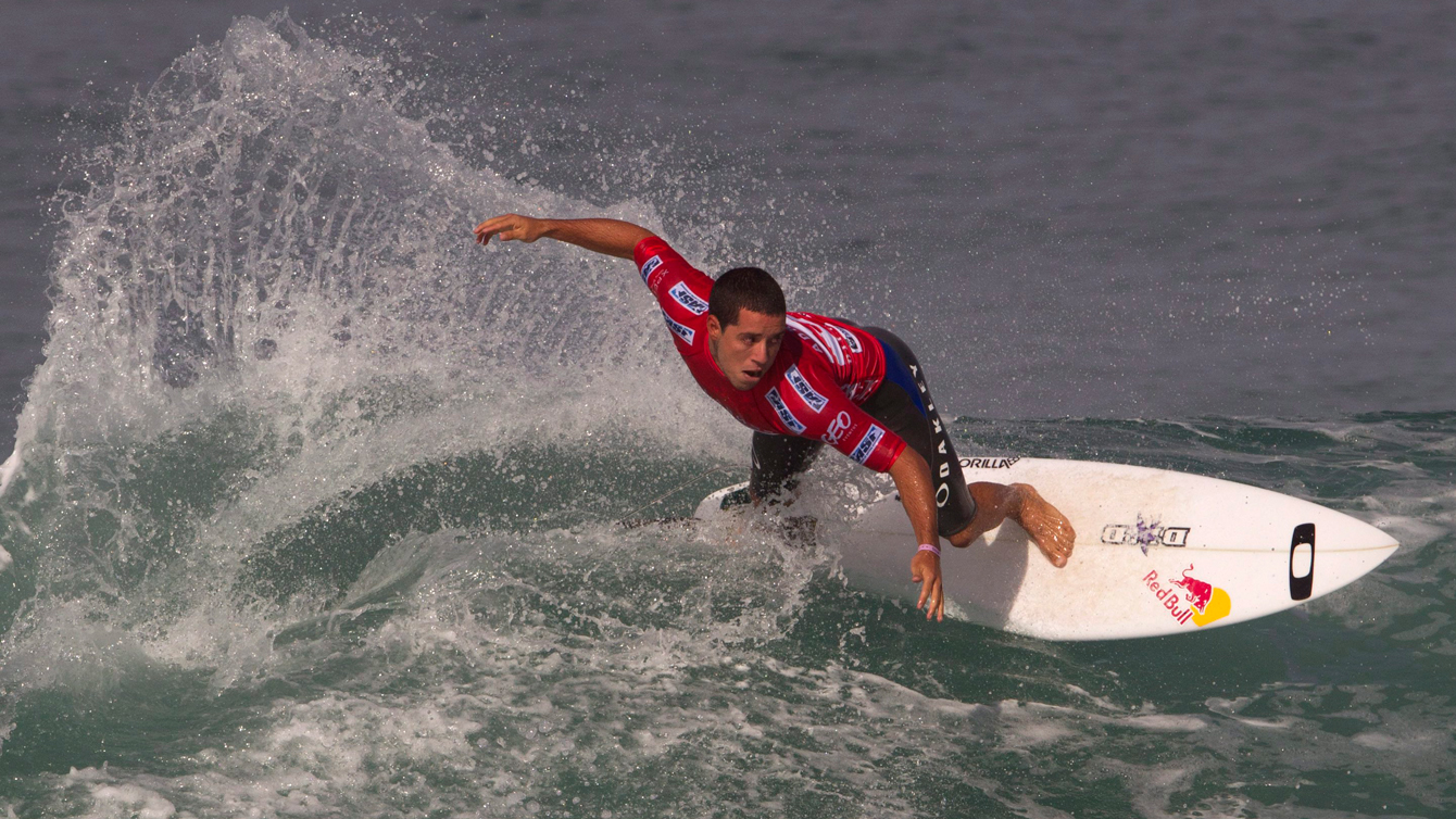 Brazil's Adriano de Souza competes in the round one of the Billabong Rio Pro men's surfing competition in Rio de Janeiro, Brazil, Wednesday, May 9, 2012. (AP Photo/Silvia Izquierdo)