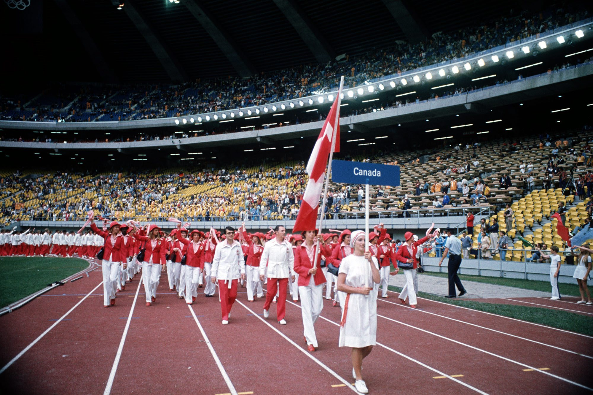 Abby Hoffman carries the Canadian Flag as she leads her team into the Olympic stadium in Montreal July 17, 1976 during the opening ceremonies for the games. Hoffman, 29, from Toronto, will compete in the 800 meter run. (CP PHOTO/ file)