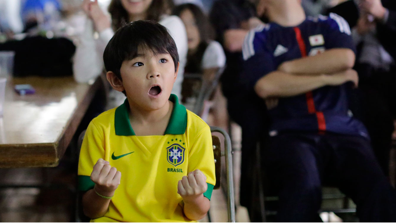 A young Brazilian soccer fan reacts as he watches the opening Confederations Cup soccer match between Brazil and Japan at a community center in the Liberdade neighborhood or Japantown, in Sao Paulo, Brazil, Saturday, June 15, 2013.