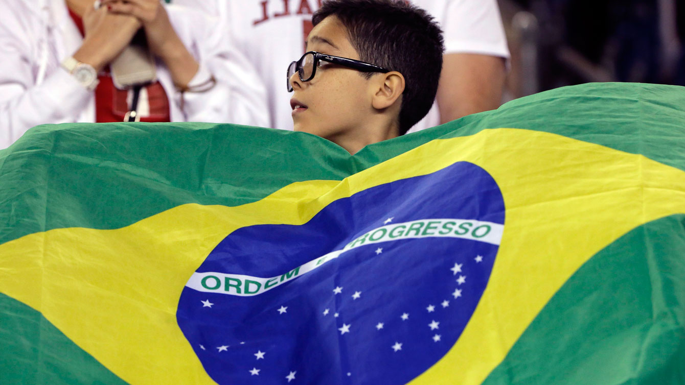 A young Brazil supporter waves his country's flag before a Copa America Group B soccer match between Brazil and Peru on Sunday, June 12, 2016, in Foxborough, Mass. (AP Photo/Steven Senne)