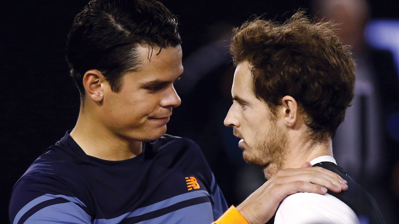 Andy Murray, right, of Britain is congratulated by Milos Raonic of Canada after winning their semifinal at the Australian Open tennis championships in Melbourne, Australia, Friday, Jan. 29, 2016.(AP Photo/Rafiq Maqbool)