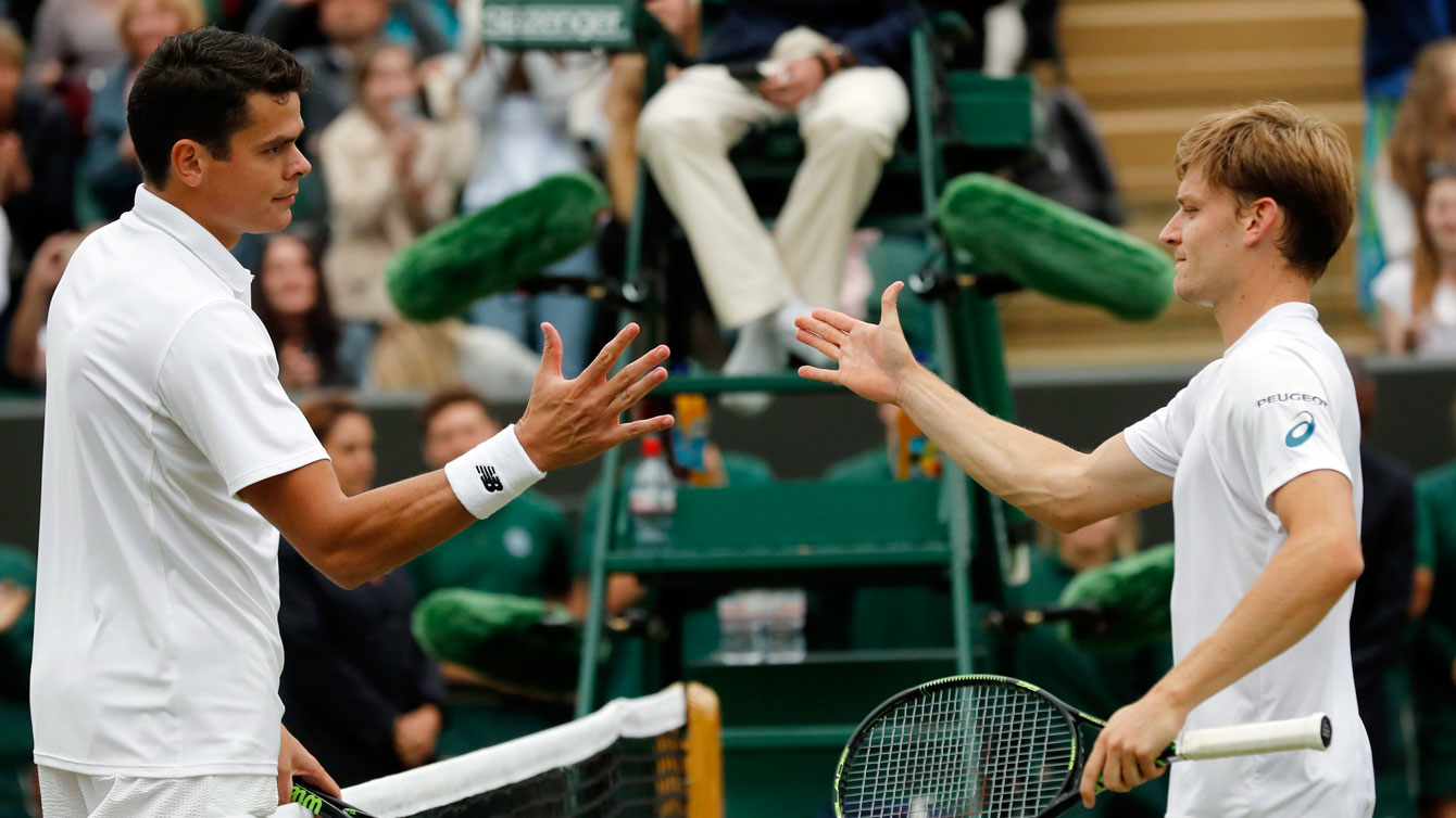 Milos Raonic (left) shakes hands with David Goffin after their fourth round Wimbledon match on July 4, 2016.