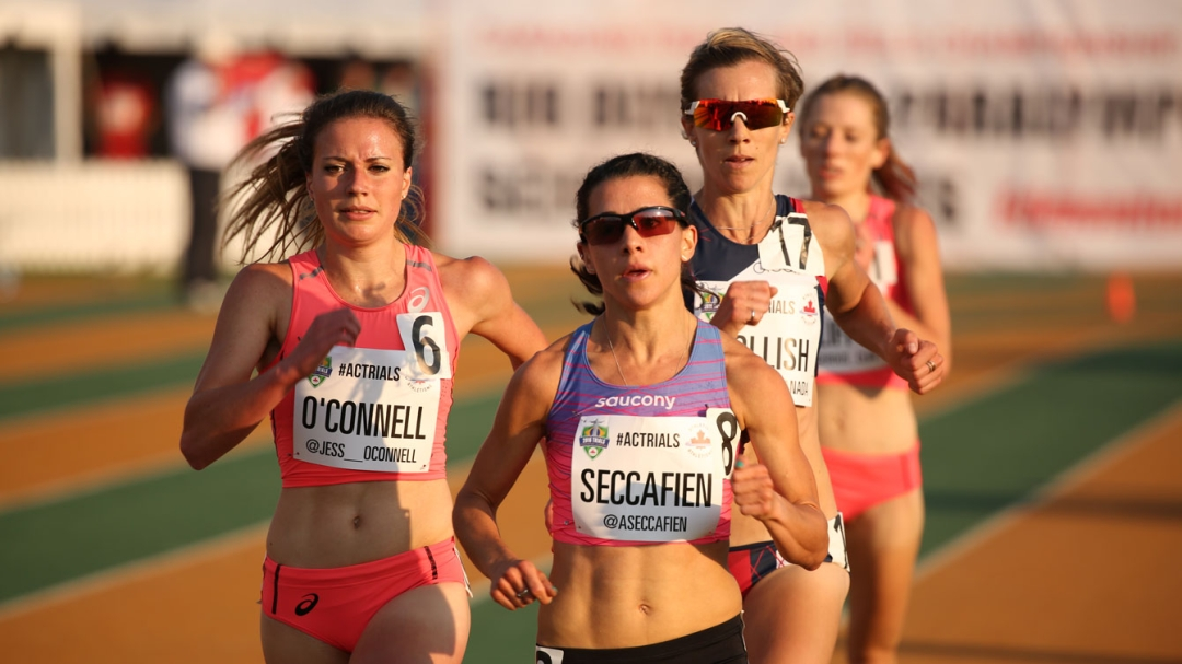 Andrea Seccafien with other athletes trailing behind her