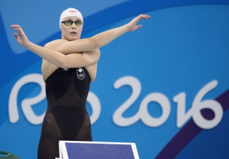Canada's Penny Oleksiak warms up for her silver medal performance in the women's 100-metre butterfly at the 2016 Summer Olympics on Sunday, August 7, 2016 in Rio de Janeiro, Brazil. THE CANADIAN PRESS/Frank Gunn