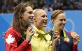 Winner Sweden's Sarah Sjostrom, center, second placed Canada's Penny Oleksiak, left, and third placed United States' Dana Vollmer hold their medals after the women's 100-meter butterfly during the swimming competitions at the 2016 Summer Olympics, Sunday, Aug. 7, 2016, in Rio de Janeiro, Brazil. (AP Photo/Lee Jin-man)