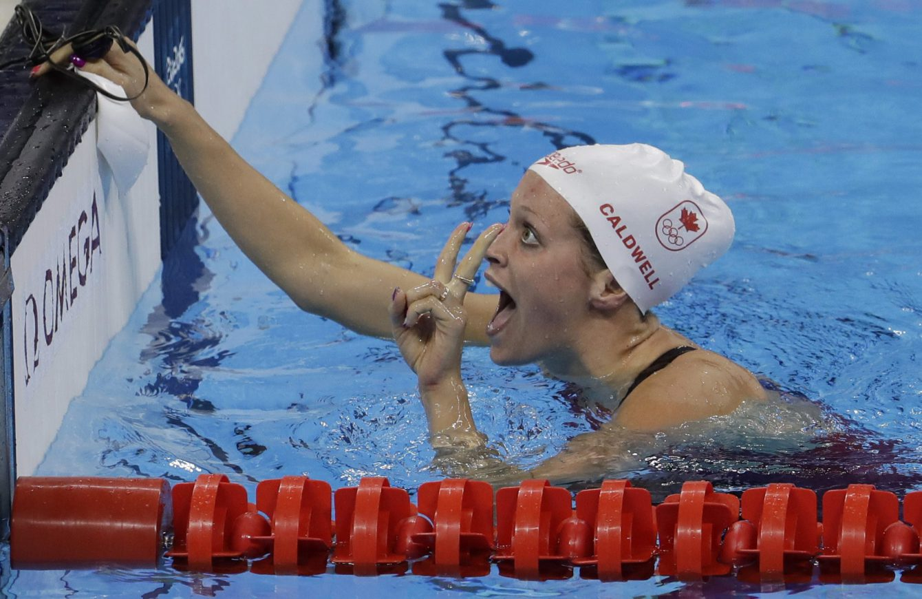 Canada's Hilary Caldwell celebrates winning a semifinal of the women's 200-meter backstroke during the swimming competitions at the 2016 Summer Olympics, Thursday, Aug. 11, 2016, in Rio de Janeiro, Brazil. (AP Photo/Natacha Pisarenko)