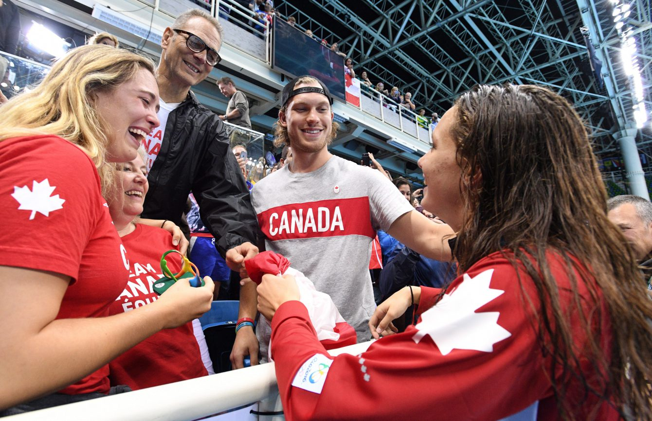 Canada's Penny Oleksiak celebrates her gold-medal win with family, including her brother, Dallas Stars' Jamie Oleksiak, second from right, in the women's 100m freestyle finals during the 2016 Olympic Summer Games in Rio de Janeiro, Brazil, on Friday, Aug. 12, 2016. THE CANADIAN PRESS/Sean Kilpatrick