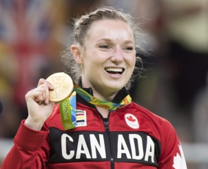 Canada's Rosie MacLennan, from King City, Ont., holds up her gold medal after winning the trampoline gymnastics competition at the 2016 Summer Olympics Friday, August 12, 2016 in Rio de Janeiro, Brazil.THE CANADIAN PRESS/Ryan Remiorz