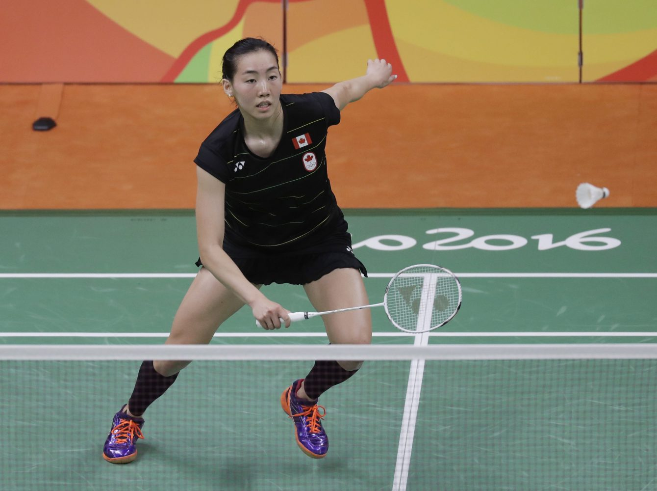 Canada's Michelle Li returns a shot to Hungary's Laura Sarosi during a Women's single match at the 2016 Summer Olympics in Rio de Janeiro, Brazil, Saturday, Aug. 13, 2016. (AP Photo/Kin Cheung)