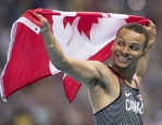 Canada's Andre De Grasse celebrates bronze in the men's 100-metre final during the athletics competition at the 2016 Olympic Summer Games in Rio de Janeiro, Brazil on Sunday, August 14, 2016. THE CANADIAN PRESS/Frank Gunn