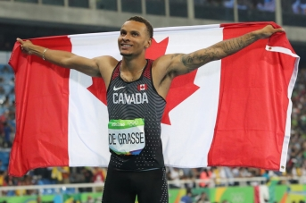 Canada's Andre De Grasse celebrates after winning bronze in the men's 100-meter during the athletics competitions of the 2016 Summer Olympics at the Olympic stadium in Rio de Janeiro, Brazil, Sunday, Aug. 14, 2016. (AP Photo/Lee Jin-man)