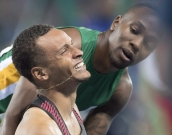 South Africa's Akani Simbine, right, congratulates Canada's Andre De Grasse on winning the bronze medal in the men's 100-metre final during the athletics competition at the 2016 Olympic Summer Games in Rio de Janeiro, Brazil on Sunday, August 14, 2016. THE CANADIAN PRESS/Frank Gunn
