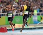 Jamaica's Usain Bolt celebrates as he crosses the line to win gold in the men's 100-meter final with Canada's Andre de Grasse during the athletics competitions of the 2016 Summer Olympics at the Olympic stadium in Rio de Janeiro, Brazil, Sunday, Aug. 14, 2016. (AP Photo/Lee Jin-man)