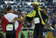 Jamaica's gold medal winner Usain Bolt is congratulated by Canada's Andre De Grasse after the men's 100-meter final during the athletics competitions of the 2016 Summer Olympics at the Olympic stadium in Rio de Janeiro, Brazil, Sunday, Aug. 14, 2016. (AP Photo/Matt Dunham)