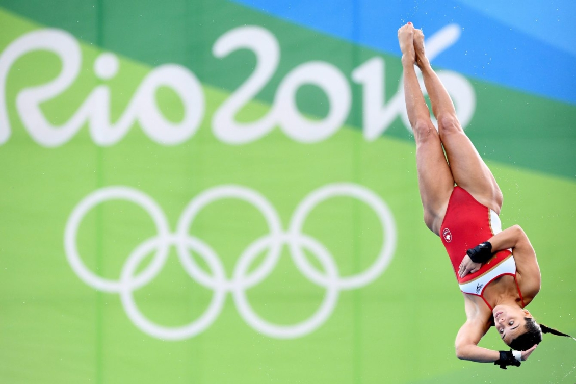 Meaghan Benfeito performs a layout dive