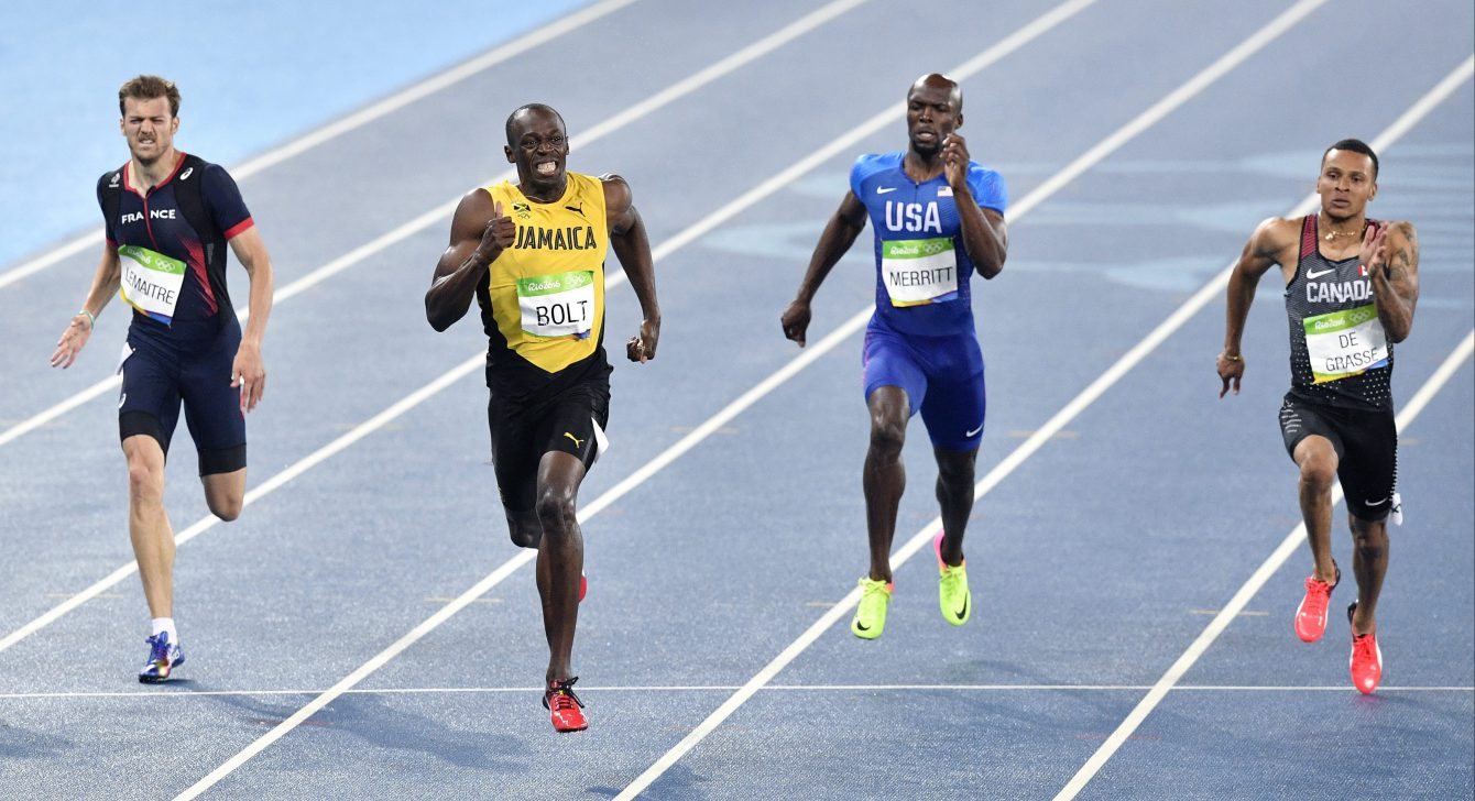 Usain Bolt from Jamaica, second left, wins the gold medal in the men's 200-meter final ahead of second placed Canada's Andre De Grasse, right, and third placed France's Christophe Lemaitre, left, during the athletics competitions of the 2016 Summer Olympics at the Olympic stadium in Rio de Janeiro, Brazil, Thursday, Aug. 18, 2016. (AP Photo/Martin Meissner)