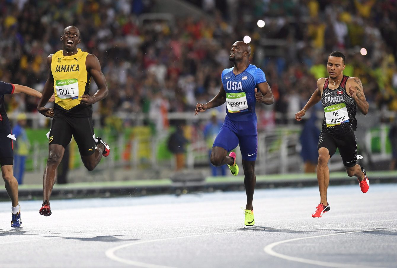 Jamaica's Usain Bolt, left to right, United States' Lashawn Merritt and Canada's Andre De Grasse react after crossing the finish line in the men's 200-metre final at the 2016 Summer Olympics in Rio de Janeiro, Brazil on Thursday, August 18, 2016. THE CANADIAN PRESS/Frank Gunn