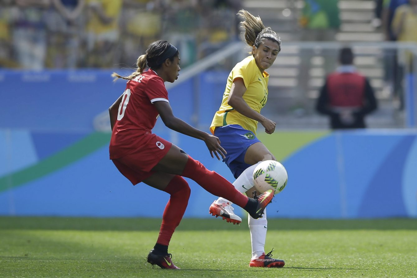 Brazil's Marta, right, and Canada's Ashley Lawrence compete for the ball during the bronze medal match of the women's Olympic football tournament between Brazil and Canada at the Arena Corinthians stadium in Sao Paulo, Friday Aug. 19, 2016. (AP Photo/Nelson Antoine)