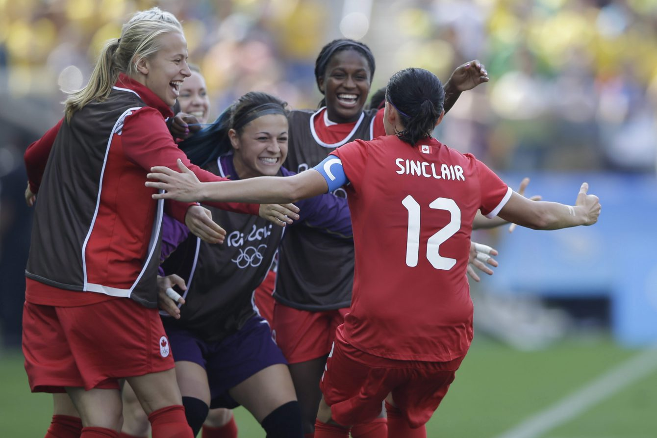 Canada's Christine Sinclair, 12, is congratulated after scoring her side's 2nd goal during the bronze medal match of the women's Olympic football tournament between Brazil and Canada at the Arena Corinthians stadium in Sao Paulo, Friday Aug. 19, 2016. (AP Photo/Nelson Antoine)