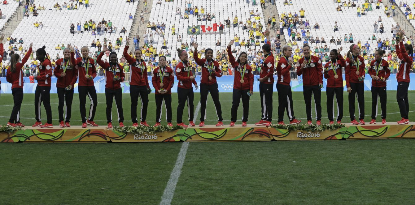 Canada team stands on the podium after winning the bronze medal in the women's Olympic football tournament between Brazil and Canada at the Arena Corinthians stadium in Sao Paulo, Friday Aug. 19, 2016. (AP Photo/Nelson Antoine)