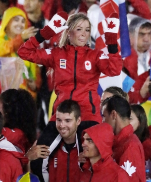 Canadian athlete on shoulders of another Canadian athlete