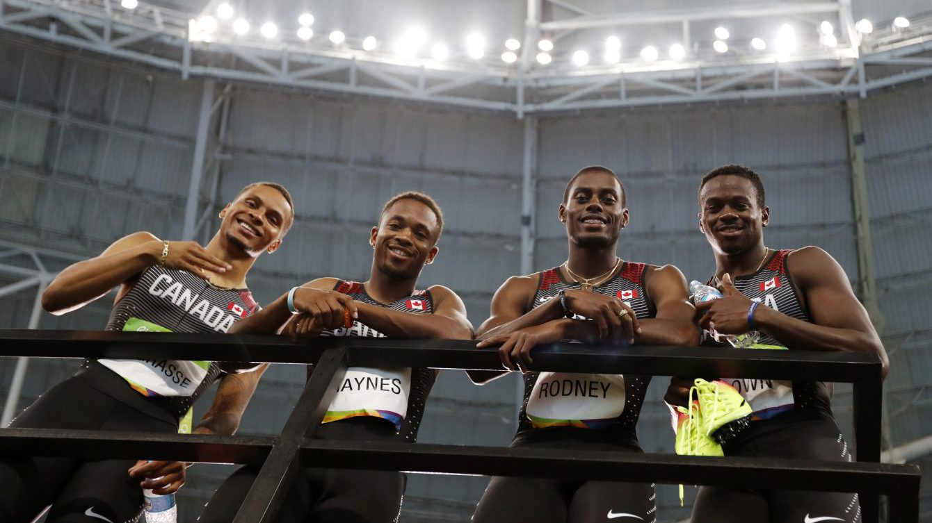 Canada's men's 4x100m relay team consisting of Andre De Grasse, Aaron Brown, Akeem Haynes and Brendon Rodney after winning bronze in the 4x100 relay at the Rio Olympic Games on August 19, 2016. (photo/ Stephen Hosier)