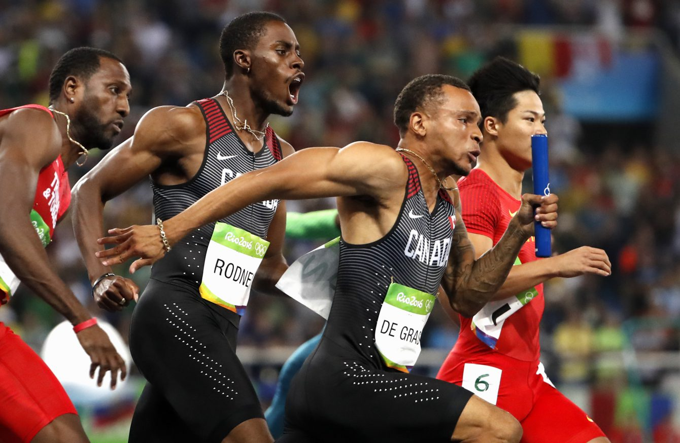 Canada's Andre De Grasse, right, and Brendon Rodney before the last part of the 4x100m relay in Rio on August 19, 2016. (photo/ Stephen Hosier)