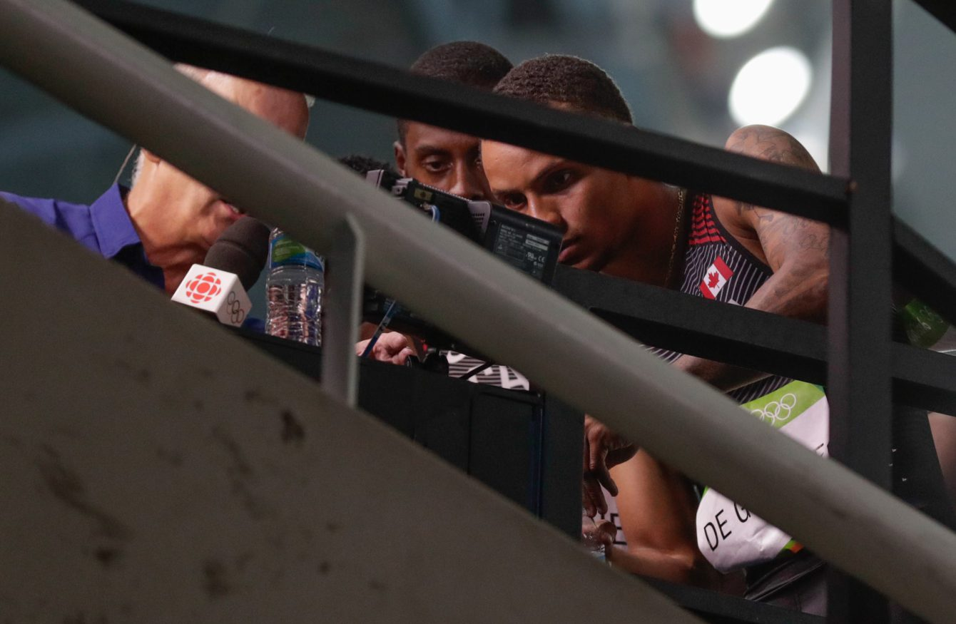 Canada's men's 4x100m relay team consisting of Andre De Grasse, Aaron Brown, Akeem Haynes and Brendon Rodney reviewing the moment in the race that pushed them to bronze. (photo/ Jason Ransom)