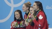 The women's 4x200m freestyle relay team celebrate their Olympic bronze medal on August 10, 2016 in Rio de Janeiro.