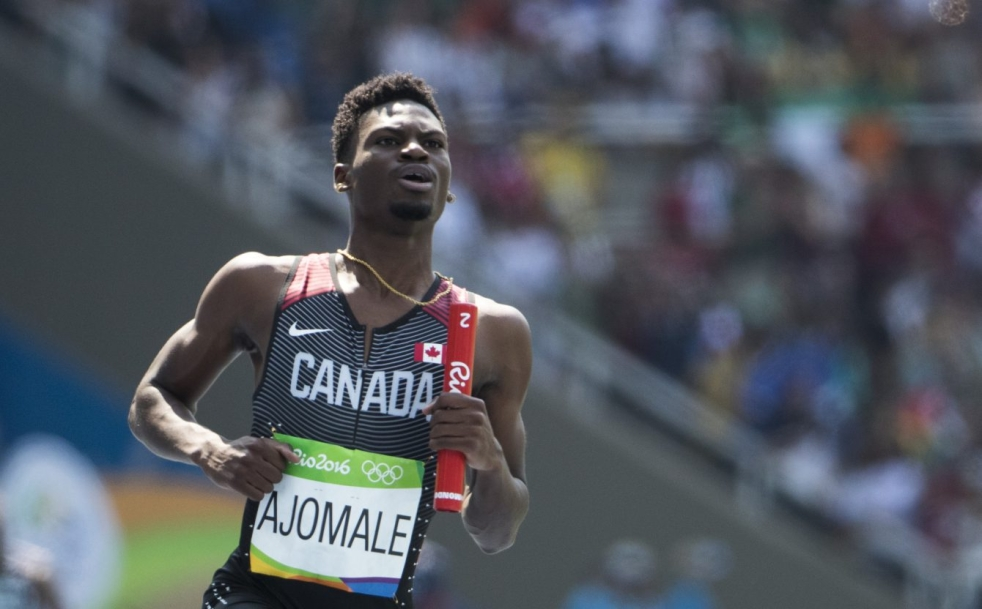 Mobolade Ajomale runs in the men's 4x100m relay qualifiers on August 18, 2016 during Rio 2016.