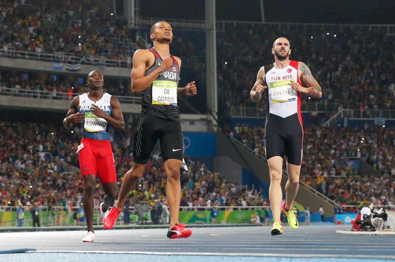 Andre De Grasse crossing the finish line in the men's 200-metre final at the 2016 Summer Olympics in Rio de Janeiro, Brazil on Thursday, August 18, 2016.  (photo/ Mark Blinch)