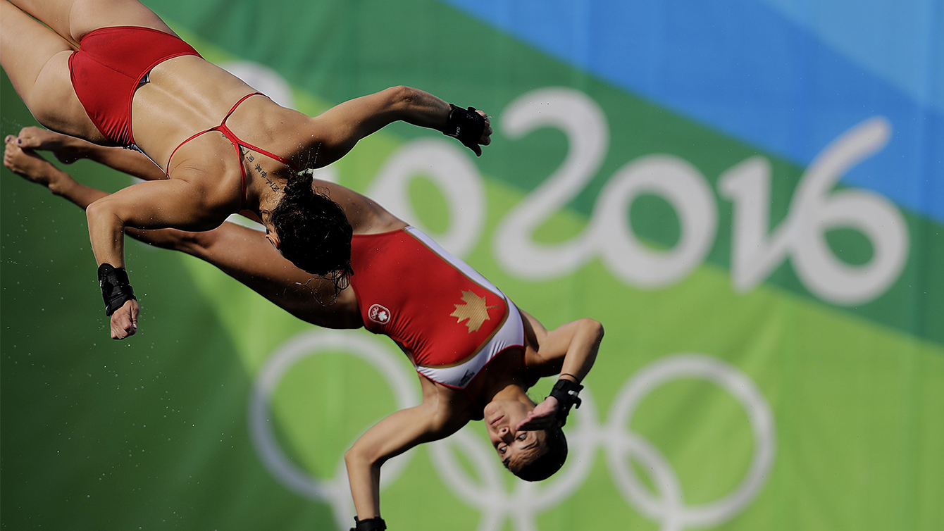 Meaghan Benfeito and Roseline Filion at the women's synchronized 10-meter platform diving final in the Maria Lenk Aquatic Center at the 2016 Summer Olympics in Rio de Janeiro, Brazil, Tuesday, Aug. 9, 2016. (AP Photo/Wong Maye-E)