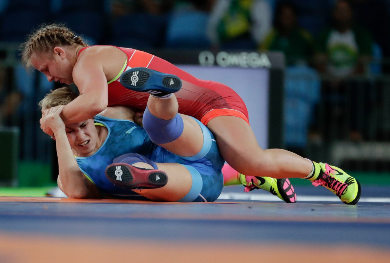 Female players competing in a wrestling match