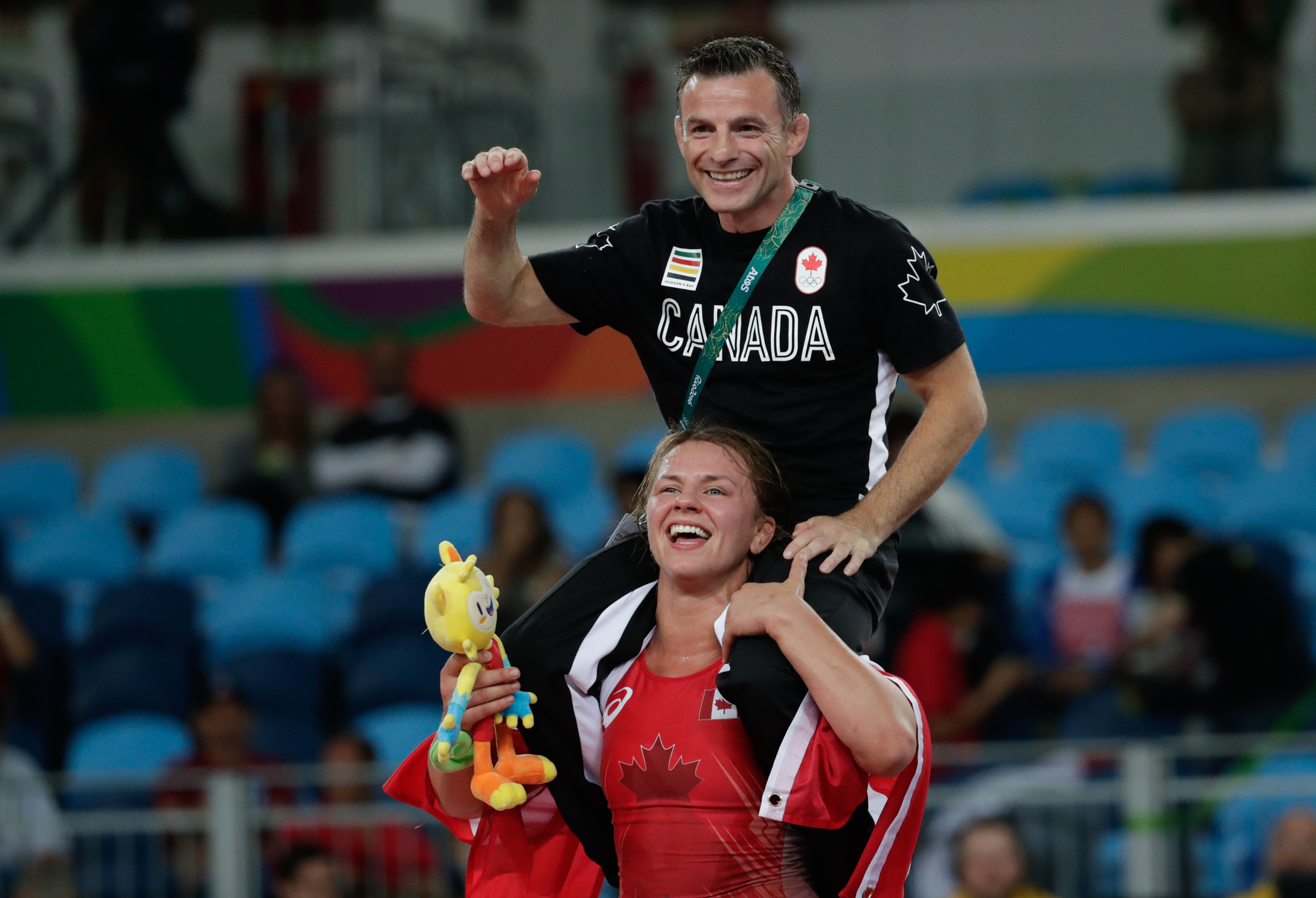 Erica Wiebe carries her coach after winning 75kg wrestling gold at Rio 2016 (COC/David Jackson)