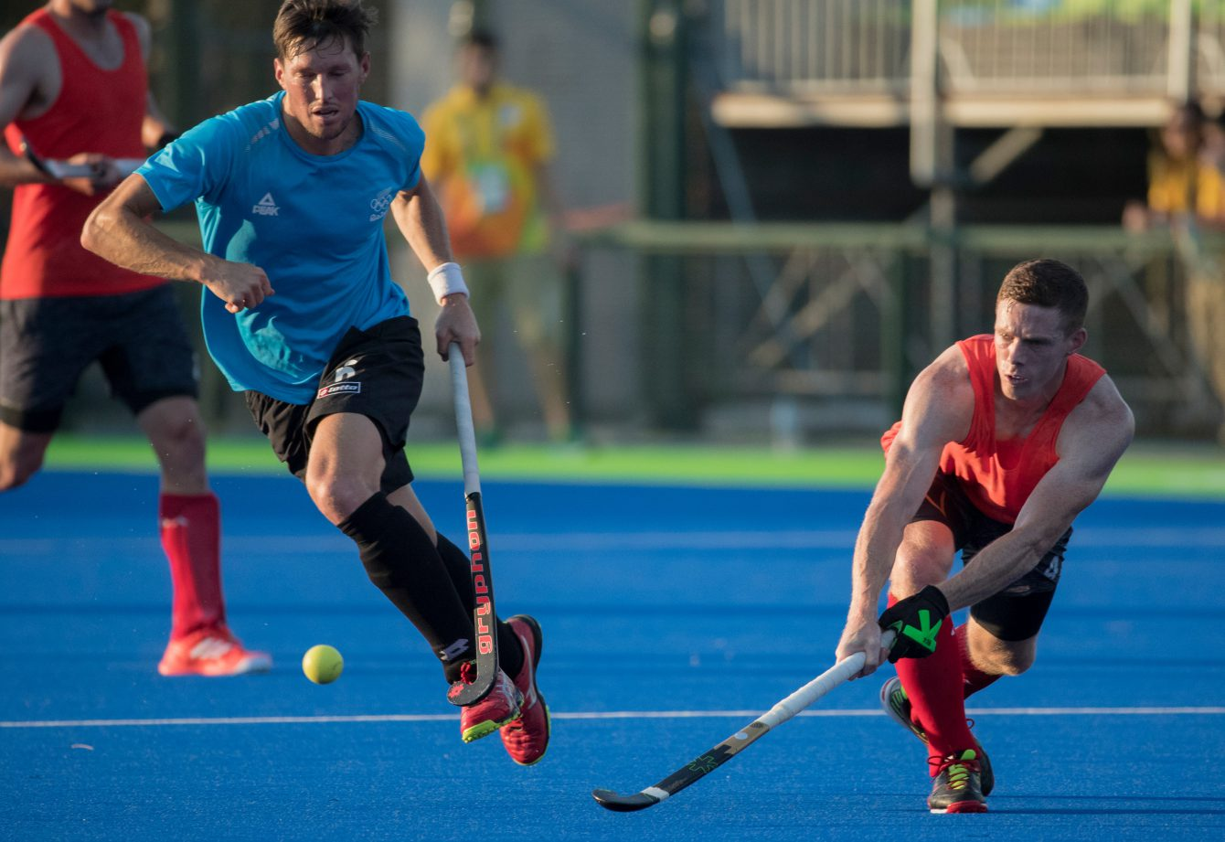 Scott Tupper passes the ball during a friendly match against New Zealand